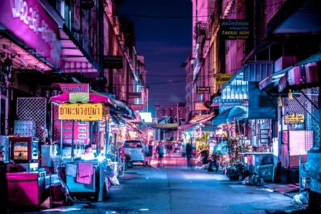 Photo: An alley in Bangkok illuminated by electric discharge tube, commonly known as neon lights.